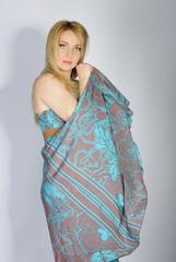 beautiful girl blonde in year bright peasant woman's dress in as