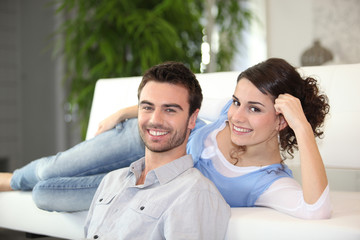 Couple in front of television