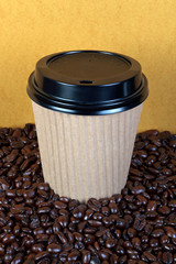 Disposable coffee cup and beans