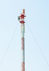 Telecommunications tower with different antenna  on blue sky