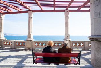 Elders sitting on a bench, Miramare castle - Trieste