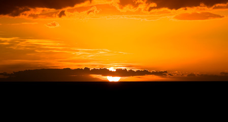 Romantic sunset above the Atlantic ocean