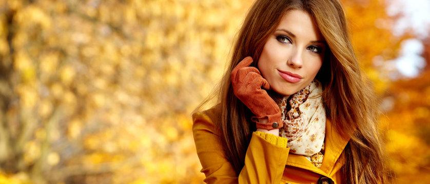 Beautiful elegant womanin autumn park