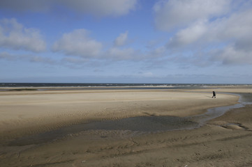 playing on north sea sands, netherlands