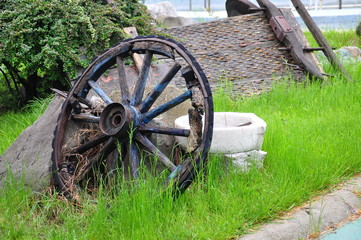 old wooden wheel of a cart