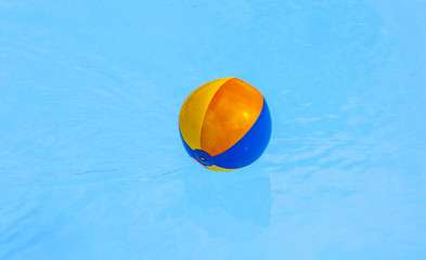inflated plastic ball in the pool