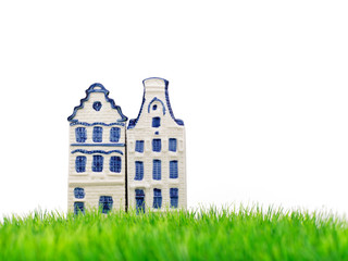 Two miniature Amsterdam canal houses on grass