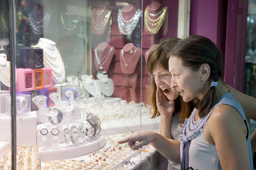 women looking jewelry counter