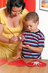 Child painting in preschool