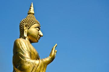 big gold image of buddha