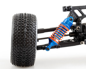 suspension of modern radio controlled car on white background