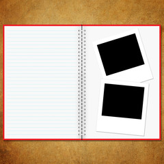 Blank notebook and photo old board background