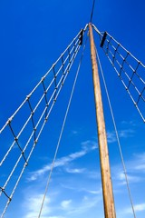 Ladder upstairs on the mast against blue sky.