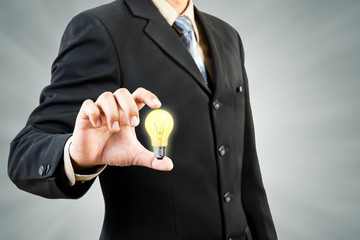 Light bulb in businessman hand