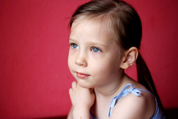 Portrait of cute beautiful little girl over pink background