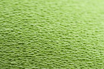 Texture of green soft plastic mat