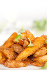 Fried potato wedges closeup