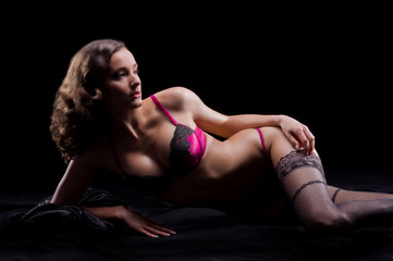 Fashion shoot of a young woman in arotic lingerie