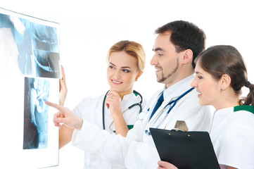 A team of young Caucasian doctors in white clothes