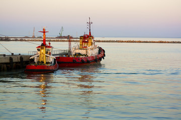 two tugboats near the pier
