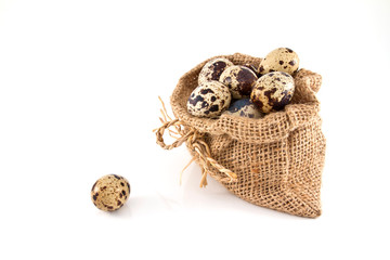 Quail eggs in canvas sack isolated on a white background