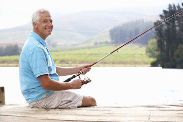 Senior man fishing on jetty