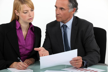 Business partners going over paperwork