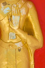 Hand of Buddha Statue on red background