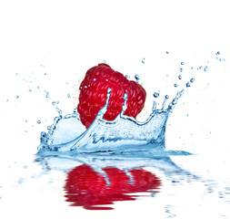 Acrylic Prints In the ice Raspberry falling into water, isolated on white background.