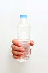 Plastic water bottle in the hand