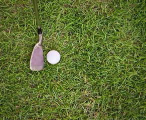 golf ball and iron on grass
