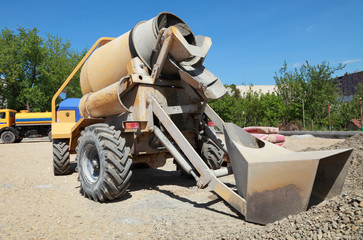 Road construction, cement mixer and gravel
