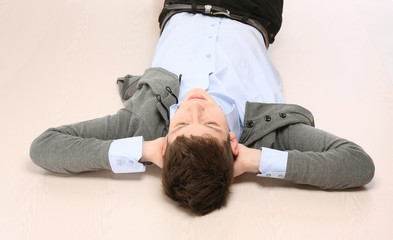 A young guy lying on the floor