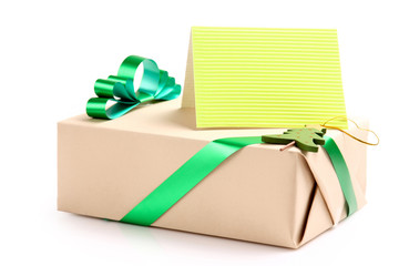 Gift with a greeting card isolated on white background