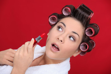 Woman with curlers and lipstick