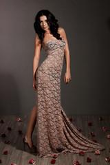 elegant fashionable woman in beige dress