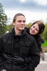Portrait of happy couple in park.