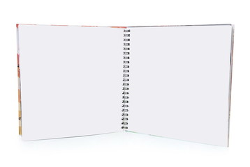 a small spiral book is empty over white background