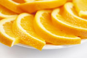 Photo sur Aluminium Tranches de fruits Orange cuts on a plate