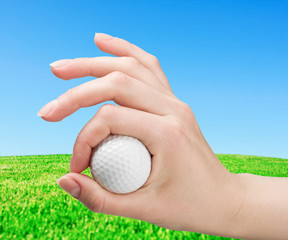 hand holds a ball for game in golf