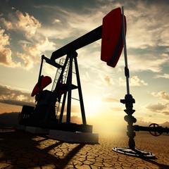 Oil pump on the sunset sky