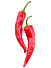 Two red chili peppers isolated on the white