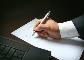 Business - Businessman signing a contract