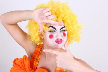Happy clown take a photo
