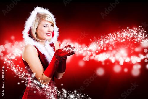weihnachtsfrau mit magischem sternchenlicht stockfotos. Black Bedroom Furniture Sets. Home Design Ideas