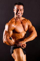 male bodybuilder on black background