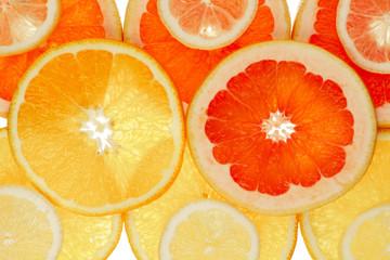 Tuinposter Plakjes fruit Fruchthintergrund aus Orange, Grapfruit und Zitronenscheiben