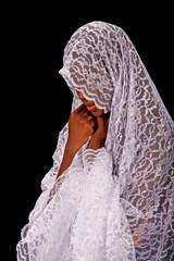 Beautiful black woman in a white veil