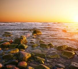 Rocky beach on a sunset.