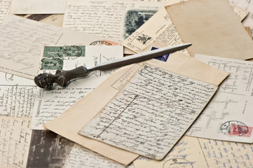 old papers and post cards with letter opener
